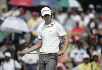 Noh of South Korea prepares for the putt on the 18th hole before winning the Malaysian Open 2010 golf tournament in Kuala Lumpur