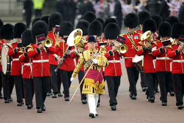 A marching band of guardsmen parade along The Mall before the wedding of Britain's Prince William and Kate Middleton in central London