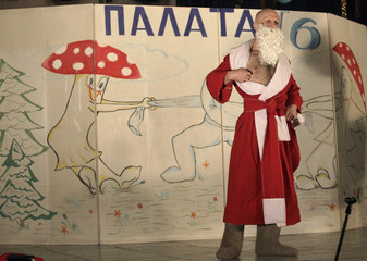 An inmate dressed as Father Frost, the Russian equivalent of Santa Claus, performs during the KVN humour competition devoted to Christmas and New Year at a high-security prison for males, in Krasnoyarsk