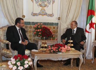 Algerian President Bouteflika speaks with Egypt's PM Kandil during their meeting at the Presidential Palace in Algiers