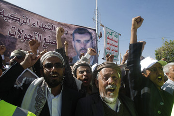 Mourners shout slogans during the funeral of Yemeni parliament member Jedban in Sanaa