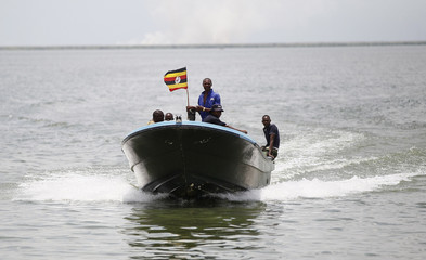 Members of the Uganda Police Marine Unit sail to the shores of Lake Albert after a search mission for the bodies of people killed after a boat carrying mostly Congolese refugees capsized in Ntoroko district in Western Uganda