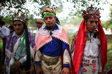 Traditional dancers participate in a traditional ceremony to commemorate the International Day of the World's Indigenous People in Izalco