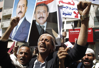 Supporters of Yemen's President Ali Abdullah Saleh shout slogans during a rally in support of him in Tahrir Square, in Sanaa