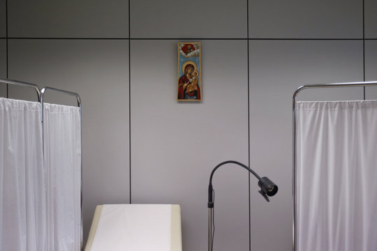 An icon depicting Virgin Mary holding Jesus Christ is seen inside a medical centre in Athens