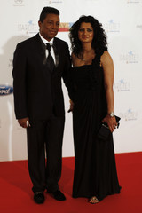 U.S. singer Jackson and his wife Halima pose during a photocall after their arrival for the Starlite Charity Gala in Benahavis