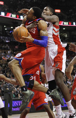 76ers' Iguodala is fouled by Raptors' Davis during their NBA basketball game in Toronto