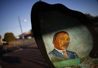 A painting of Rev. Martin Luther King Jr. is seen on a piece of art  in Selma