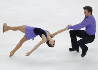 Italy's Berton and Hotarek perform during the pairs' free skating program at the ISU Grand Prix of Figure Skating Rostelecom Cup in Moscow