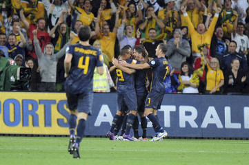 Australia's Kewell celebrates with team after scoring goal in their World Cup qualifier soccer match against Saudi Arabia in Melbourne