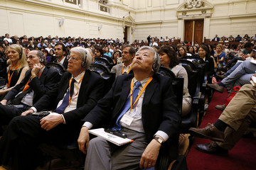 "Nobel Laureate Tonegawa listens as he attends the inaugural symposium ""Transforming Minds"" at the former Chilean Congress building in Santiago"