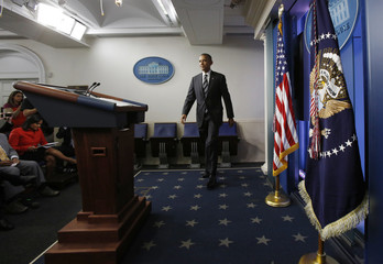 U.S. President Obama arrives in the Briefing Room of the White House to deliver remarks on Iran and the federal budget in Washington