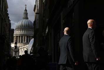 City workers walk near St Paul's Cathedral in London