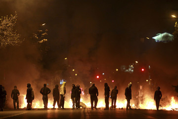 Demonstrators block a main street with barricades during a 48-hour national strike in Santiago