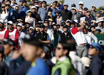 U.S. team member Johnson watches his tee shot on the second hole during the four ball matches of the 2015 Presidents Cup golf tournament at the Jack Nicklaus Golf Club in Incheon