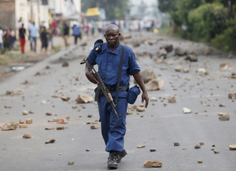 A policeman holds his rifle during a protest against Burundi President Nkurunziza and his bid for a third term in Bujumbura