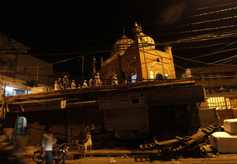 Muslims offer prayers during the holy month of Ramadan at Mubarak Begum mosque in Delhi