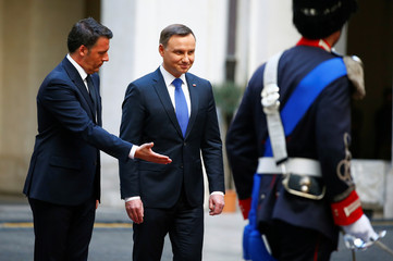 Poland's President Andrzej Duda and Italy's Prime Minister Matteo Renzi review the honour guard during a meeting at Chigi Palace in Rome, Italy