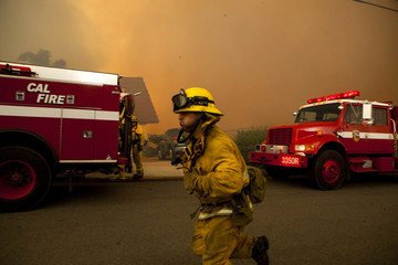 Firefighters battle the Cocos Fire in San Marcos, California