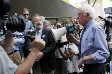 Democratic presidential candidate and U.S. Senator Bernie Sanders uses a bullhorn to speak to supporters gathered outside a town-hall campaign stop in Concord