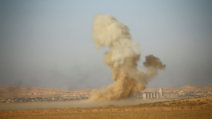 Smoke rises from clashes during a battle with Islamic State militants at the airport of Tal Afar west of Mosul
