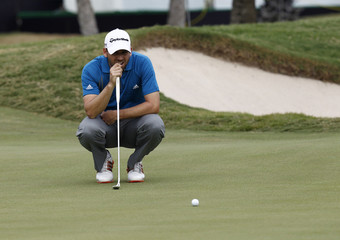 Sergio Garcia from Spain lines up his shot on the ninth hole during the third round of the Thailand Golf Championship