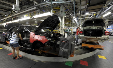 Chevrolet Malibu cars turn corner on production line at Fairfax plant in Kansas City, Kansas