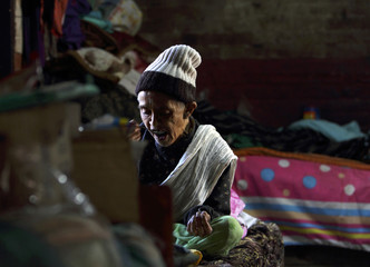 Subhadra Chalisa, 80 takes her lunch at at an old age home during International Elderly Day in Kathmandu