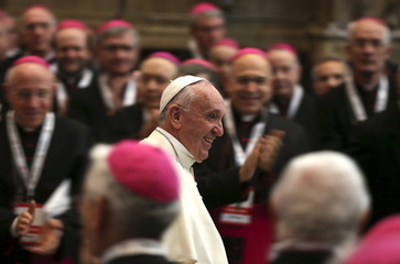 Pope Francis leaves at the end of a meeting with bishop in the baptistery of the cathedral of Florence during his pastoral visit