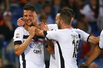 Palermo's Vazquez celebrates with his team mates after scoring against AS Roma during their Italian Serie A soccer match at the Olympic stadium in Rome