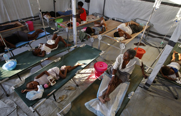 Haiti residents infected with cholera receive treatment in a clinic set up by International Red Cross in Port-au-Prince