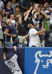Tampa Bay Rays Matt Joyce watches fans reach to catch home run hit by New York Yankees Curtis Granderson in New York