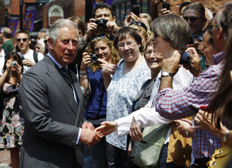 Britain's Prince Charles greets people while touring the Distillery District in Toronto