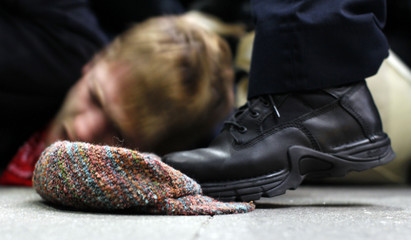 A police officer steps on the hat of an Occupy Wall Street demonstrator in New York