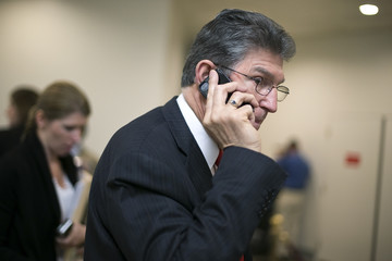 U.S. Senator Manchin talks on his mobile phone as he arrives for the weekly Democratic caucus luncheon at the U.S. Capitol in Washington