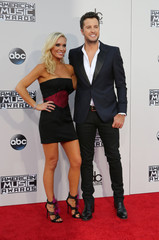 Country singer Luke Bryan and his wife Carolyn arrive at the 2015 American Music Awards in Los Angeles