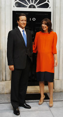 Samantha Cameron poses with waxwork of her husband Britain's Prime Minister David Cameron at Madame Tussauds in London