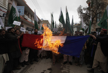 Supporters of Jamaat ahle Hadees burn the French flag in a protest against Charlie Hebdo, which featured a cartoon of Prophet Mohammad as a cover, in Quetta