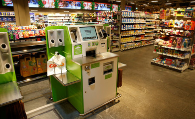 Self checkout machines are seen at a supermarket of Swiss retail group Coop in Zumikon