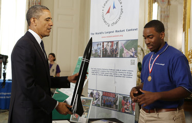 U.S. President Obama holds rocket at White House Science Fair at the White House in Washington