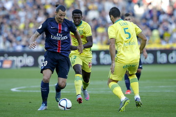 Paris St Germain's Ibrahimovic challenges FC Nantes' Toure and Cana during their French Ligue 1 soccer match at the Beaujoire stadium in Nantes