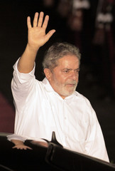 Brazil's President Luiz Inacio Lula da Silva waves upon his arrival at Comalapa's international airport