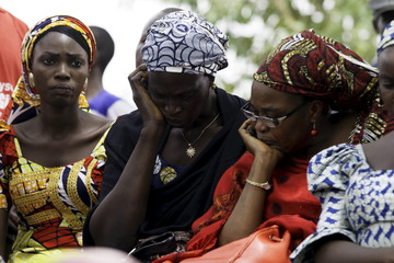 People react during the anniversary of the abduction of the girls who were abducted from a secondary school in Chibok in Abuja