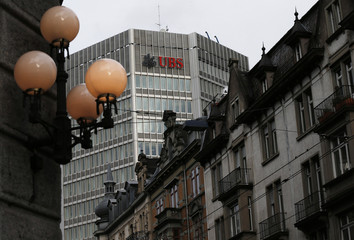 The logo of Swiss bank UBS is seen on a building in Zurich