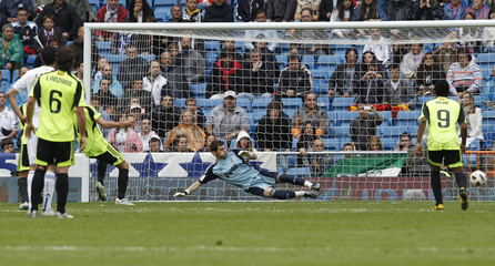 Real Zaragoza's Gabi scores a penalty goal past Real Madrid's goalkeeper Casillas during their Spanish first division soccer match at Santiago Bernabeu stadium in Madrid