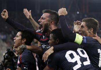 Olympiakos' Javier Saviola celebrates with his teammates after scoring against Anderlecht during their Champions League soccer match at Karaiskaki stadium in Piraeus