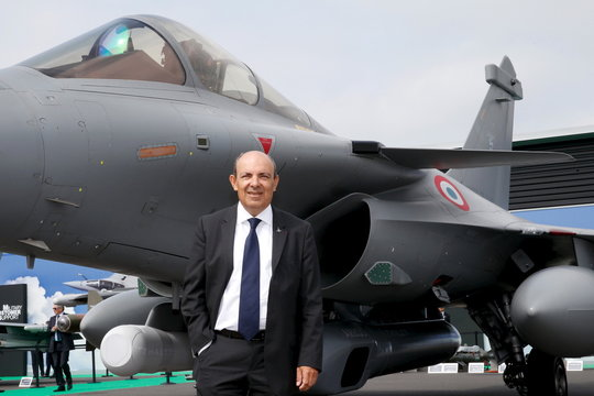 Trappier poses for pictures in front of an Dassault Rafale C fighter during the 51st Paris Air Show at Le Bourget airport near Paris