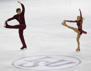Antoine and Morand of Switzerland perform during the pairs short program event at the World Figure Skating Championships in Turin