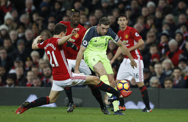 Liverpool's Jordan Henderson in action with Manchester United's Ander Herrera