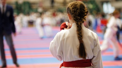 Young karate watching fighting other athletes